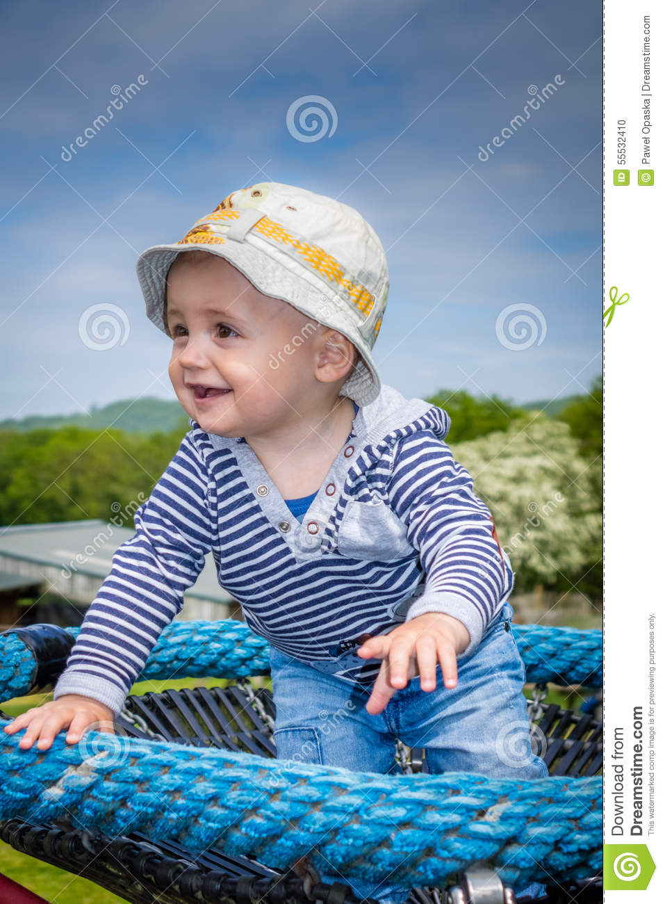 187ac2fa8 Cute little baby boy standing on a small carousel in the park playground.  More similar stock images