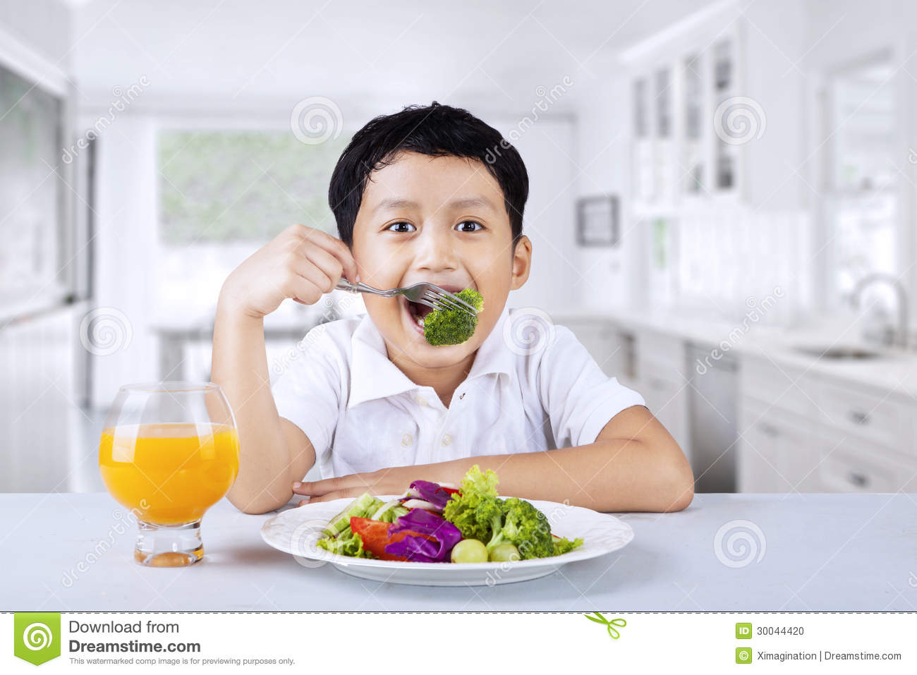 At Home boy broccoli at home stock photo image 30044420