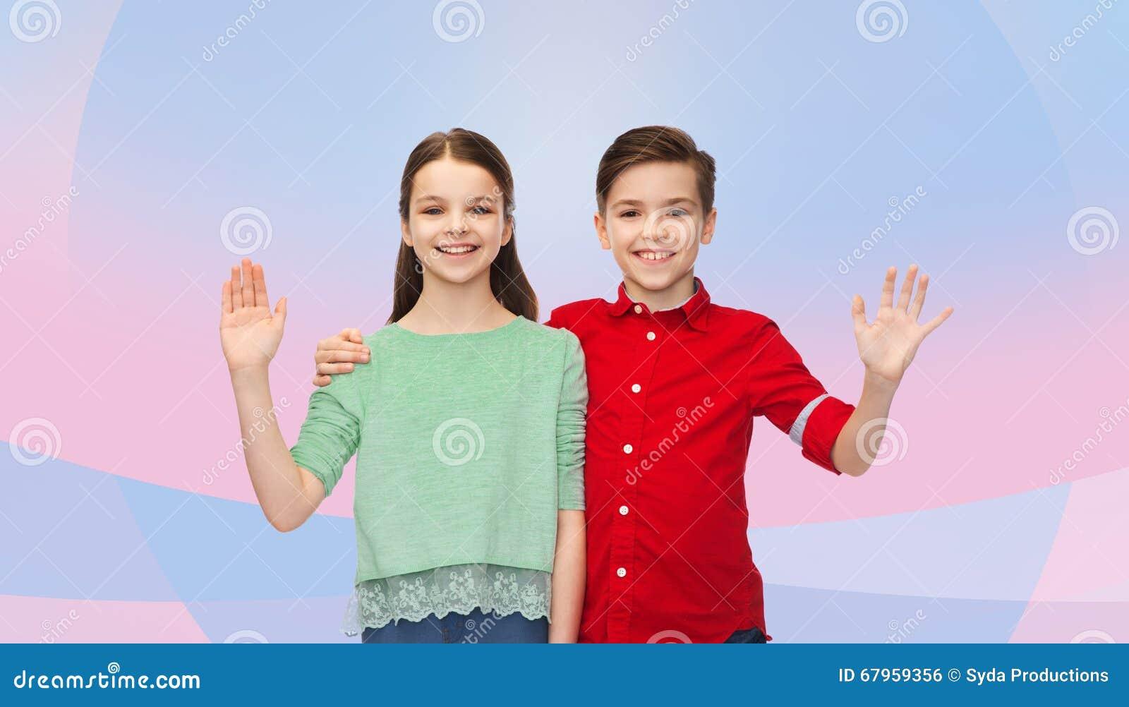 Happy Boy And Girl Waving Hand Stock Photo - Image: 67959356