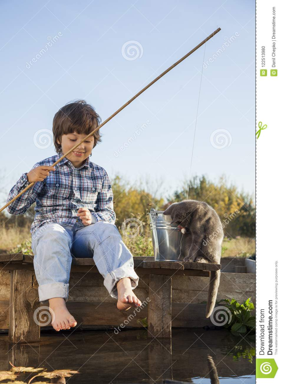 Download Happy Boy Go Fishing On The River, One Children Fisherman With A Stock Photo - Image of smiling, cheerful: 122513980
