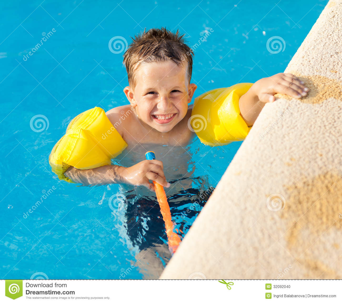 Happy boy having a fun at swimming pool stock photo image 32092040 for Mangalore swimming pool timings