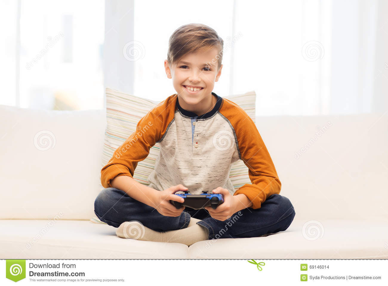 Happy Boy With Joystick Playing Video Game At Home Stock