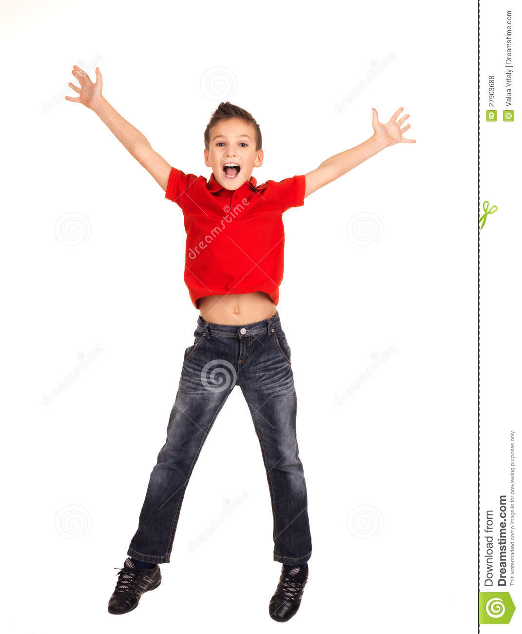Happy Boy Jumping With Raised Hands Up Stock Photo
