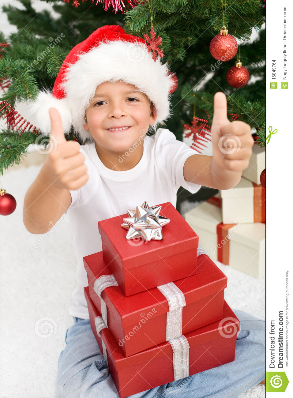 Happy Boy With Lots Of Christmas Presents Stock Images