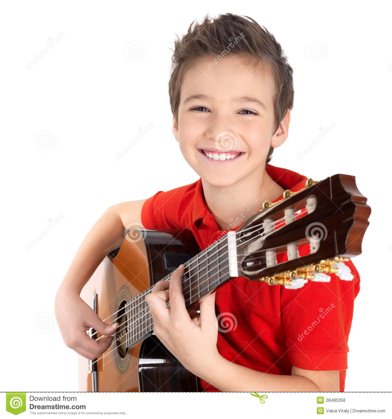 Happy Boy Is Playing On Acoustic Guitar Stock Photo