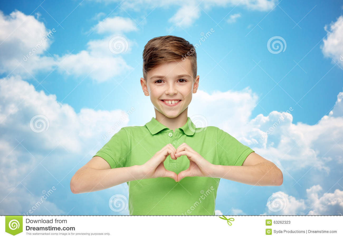 Happy Boy Showing Heart Hand Sign Over Blue Sky Stock Image ...