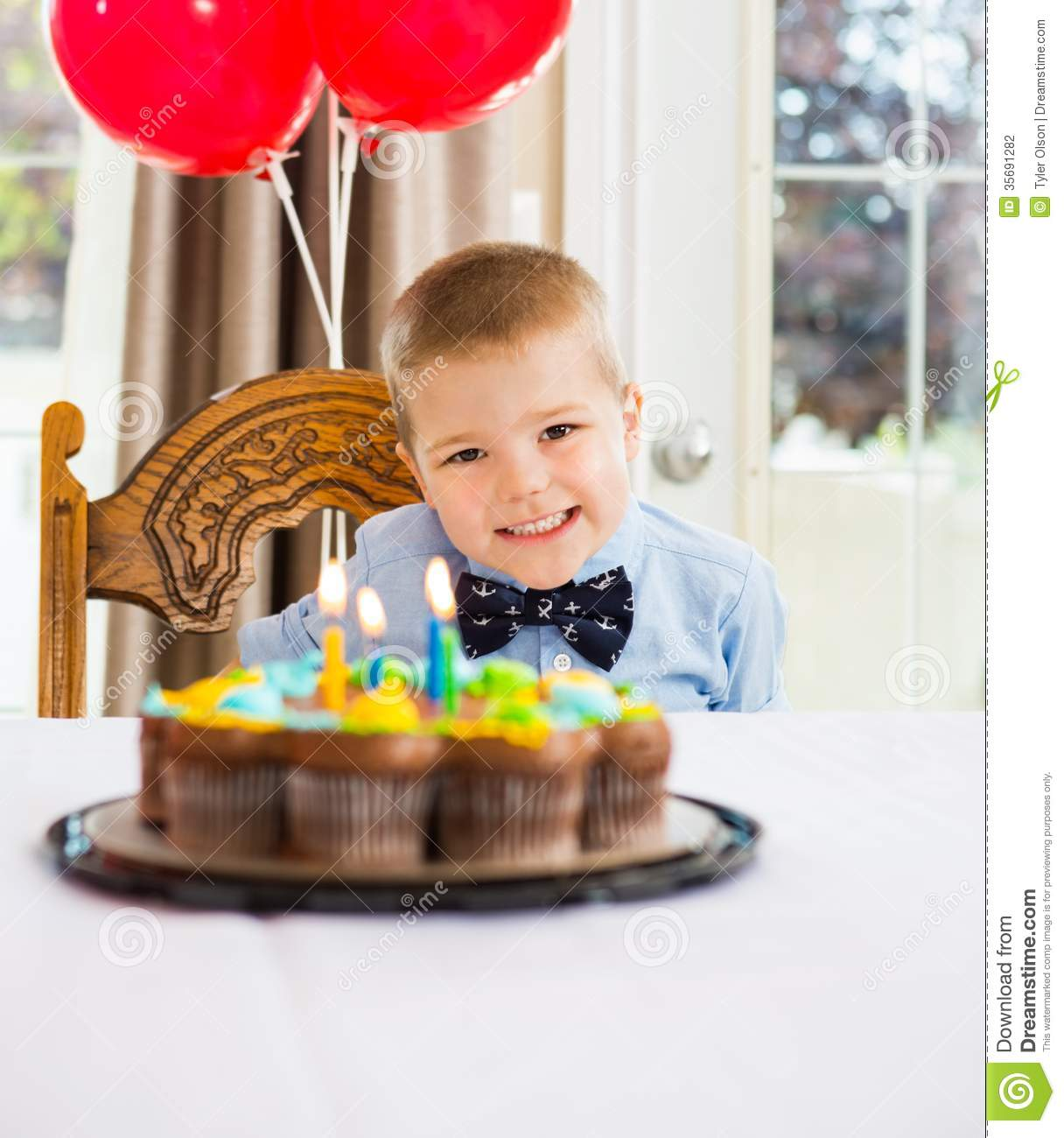 Happy Boy Sitting In Front Of Birthday Cake Stock Photo Image of