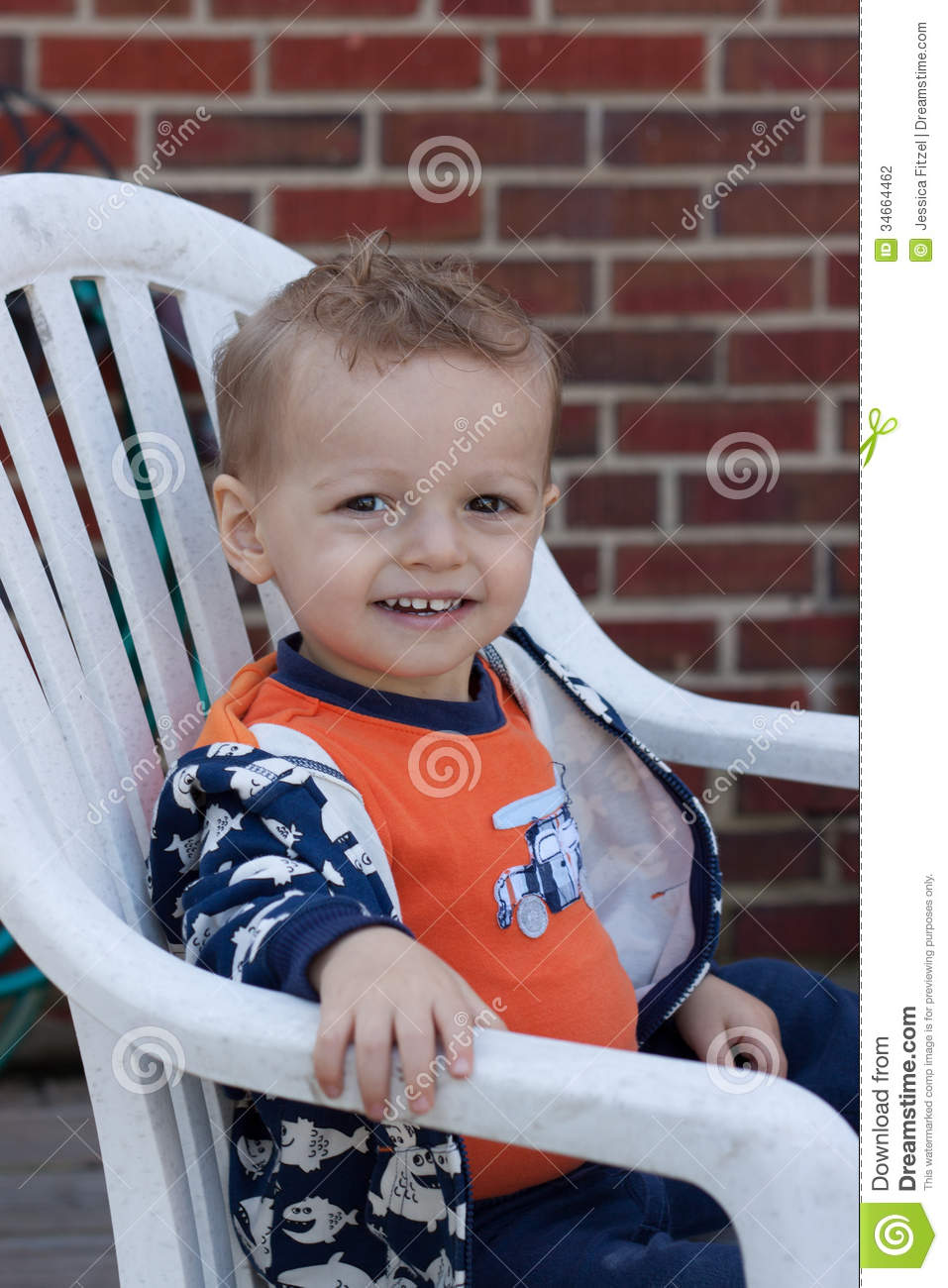 Happy boy stock photography image 34664462 for Toddler sitting chair