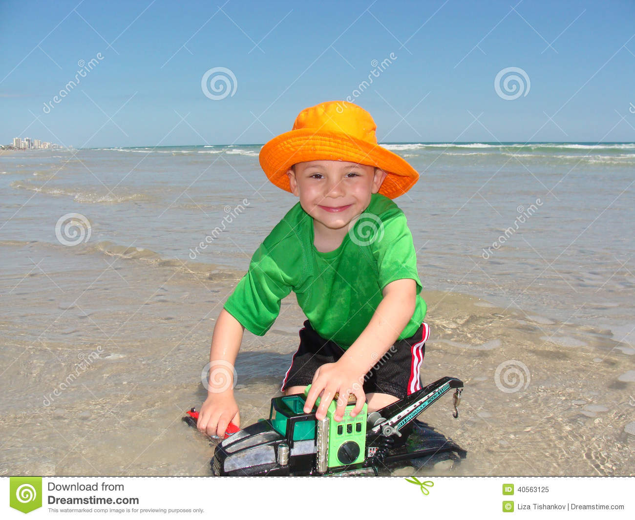 Download Happy Boy With Toy Crane On Beach Stock Image - Image of summer, truck: 40563125