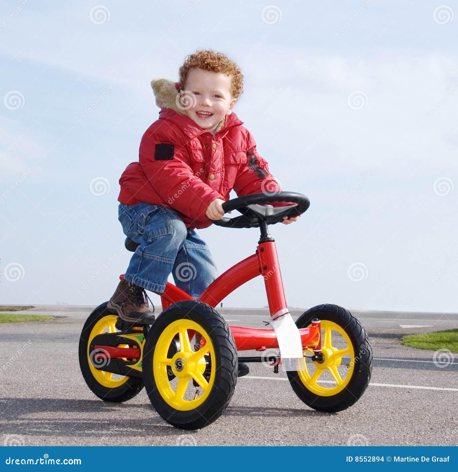Happy boy on trike, bike