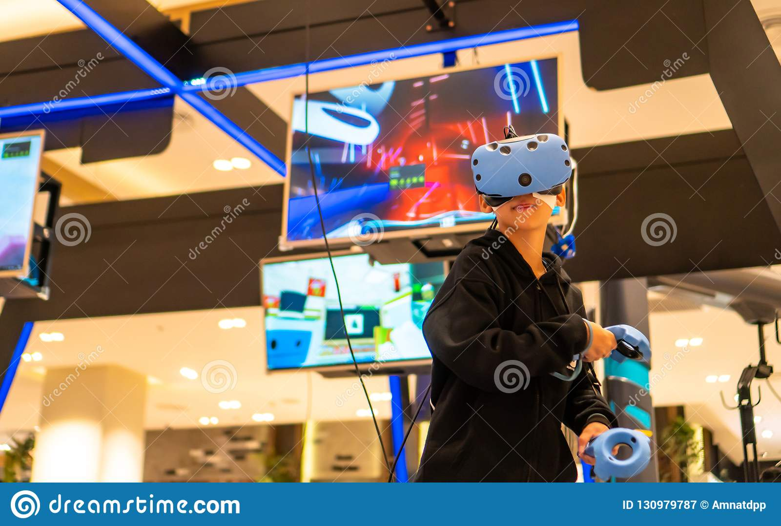 Asian people using VR for watch and play game
