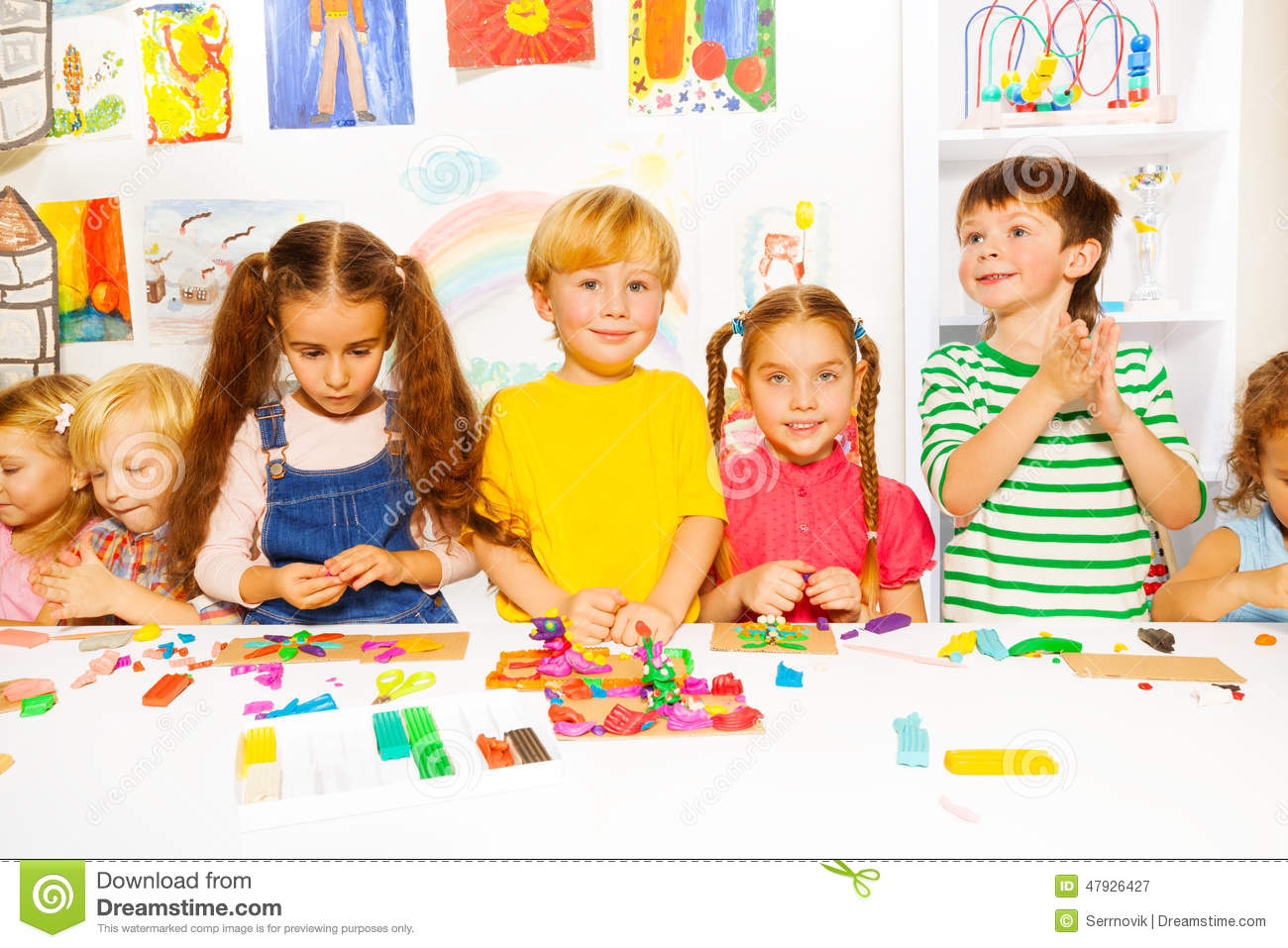 Kinder Garden: Happy Boys And Girls With Plasticine In Classroom Stock