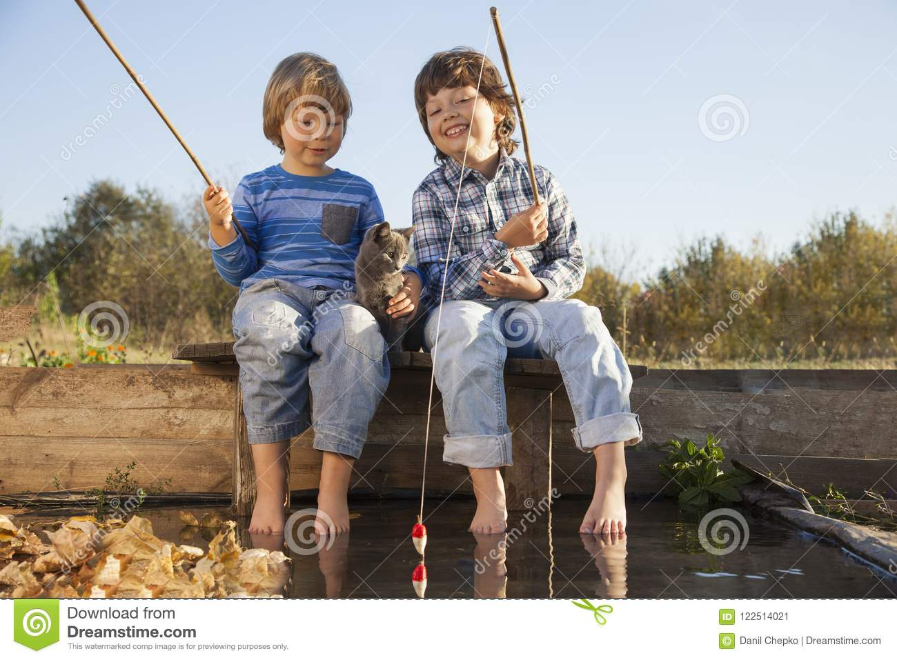 Download Happy Boys Go Fishing On The River, Two Children Of The Fisher W Stock Image - Image of child, sitting: 122514021