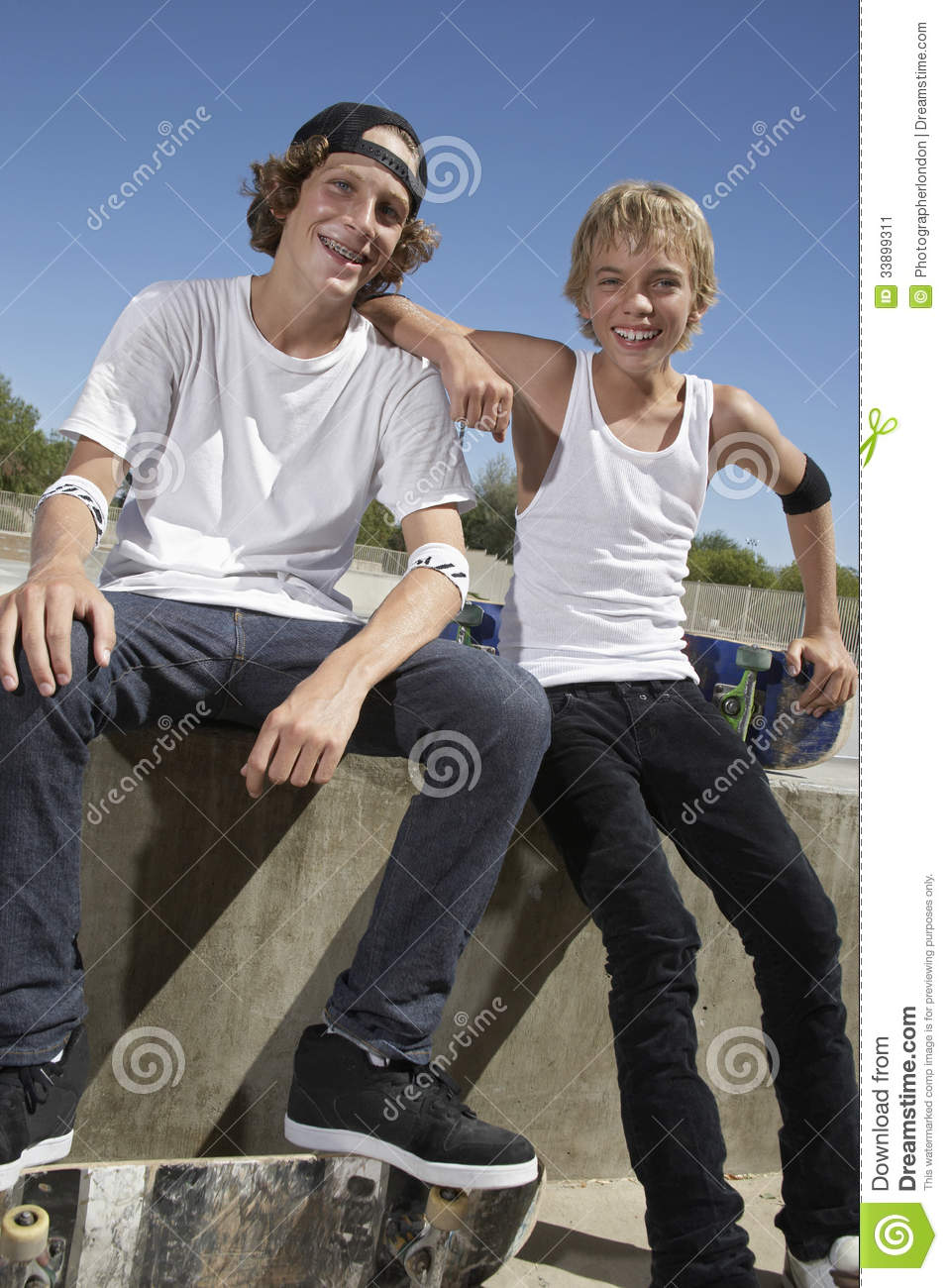 Happy Boys With Skateboard In Skate Park Stock Image