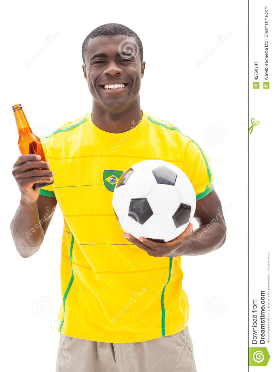Happy brazilian football fan holding ball and beer