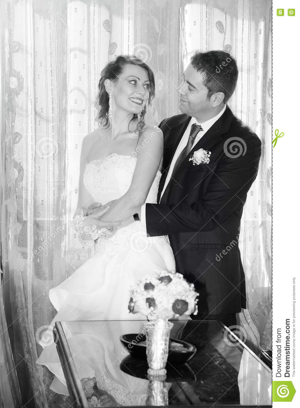 Happy bride and groom in the house. Black and white