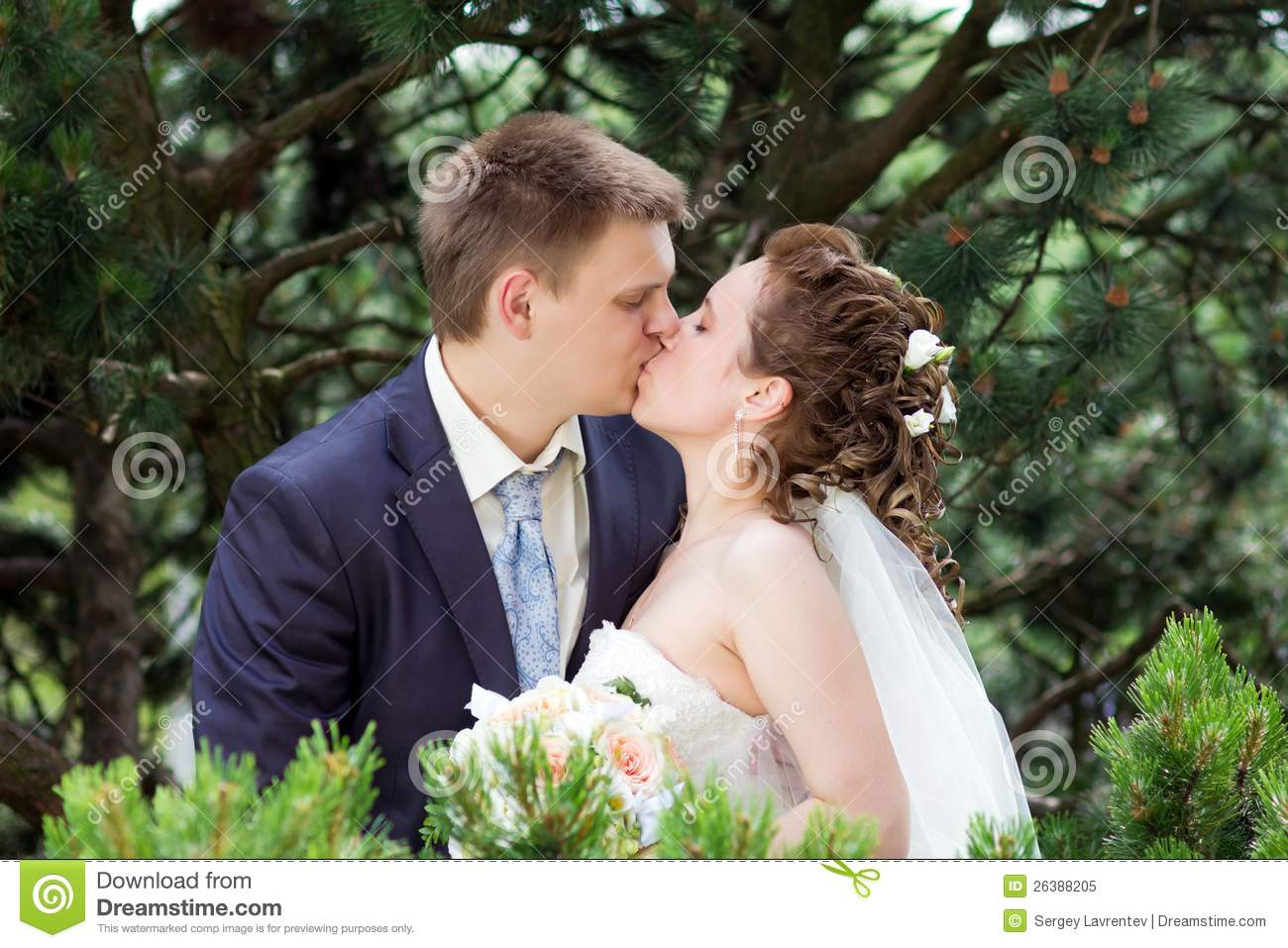 Happy Bride And Groom Kissing In Nature