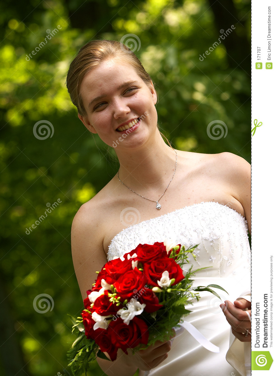 Happy bride with red bouquet
