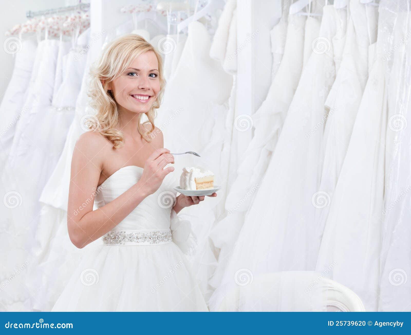 Happy bride tastes the cake