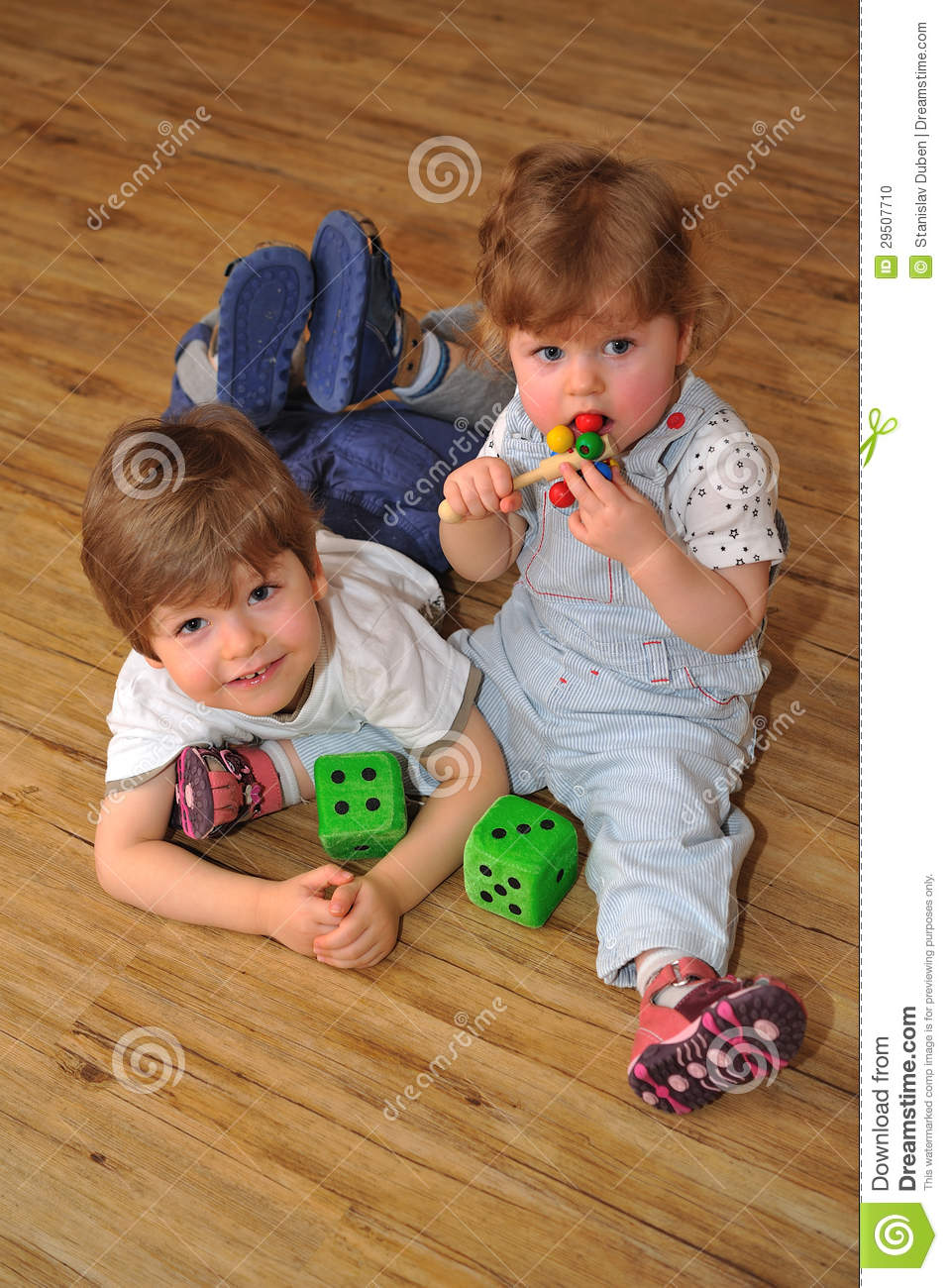 Toys For Siblings : Happy brother and sister on wooden floor with toys