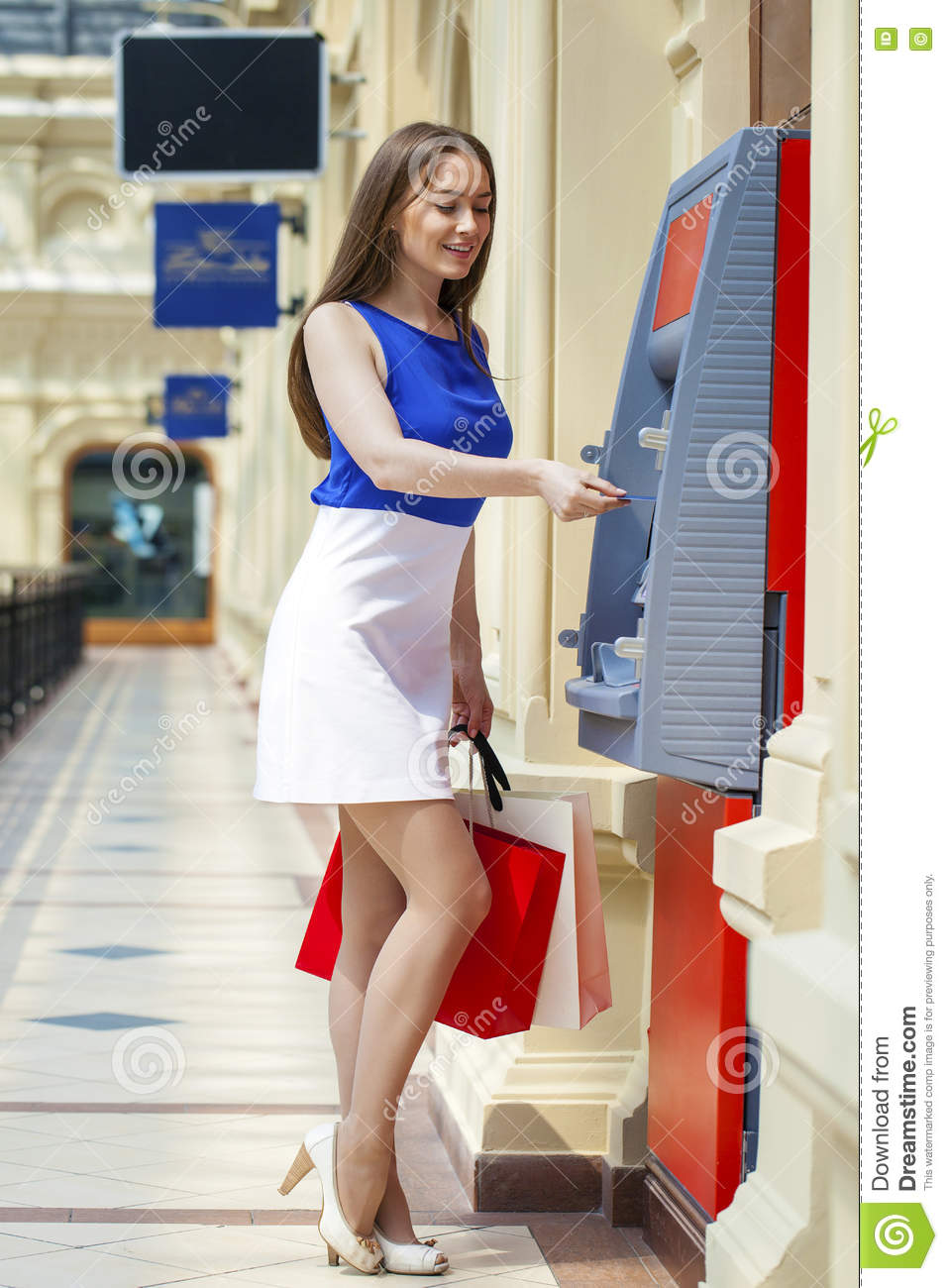 f882a984f735 Happy Brunette Woman Withdrawing Money From Credit Card At ATM Stock ...