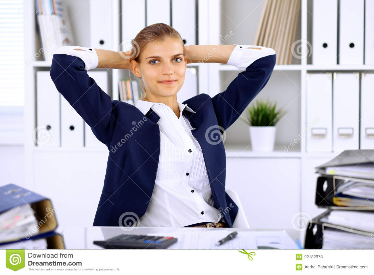 Happy business woman or female accountant having some minutes for time off and pleasure at working place