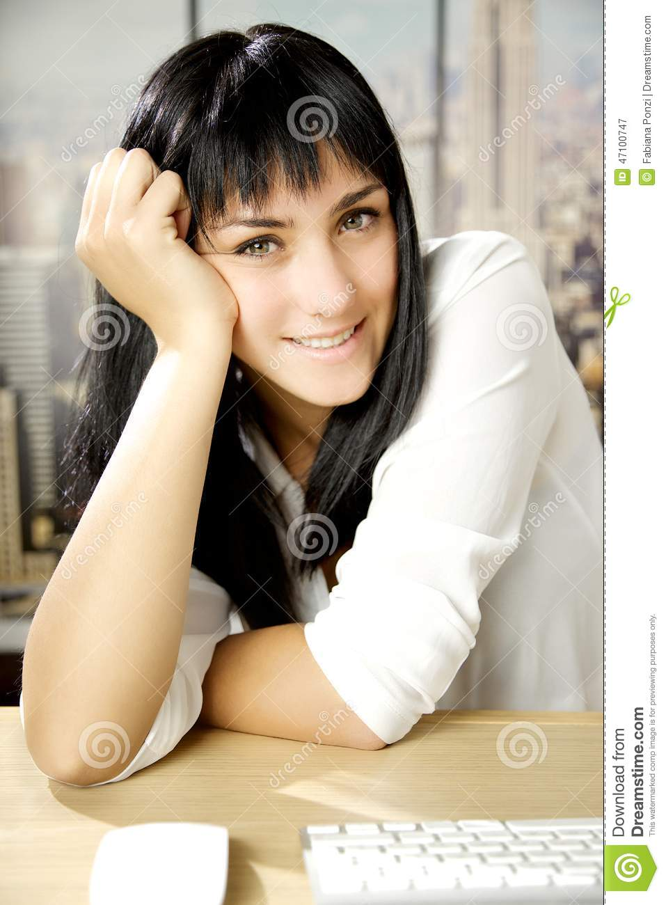 Happy business woman in office in New York looking