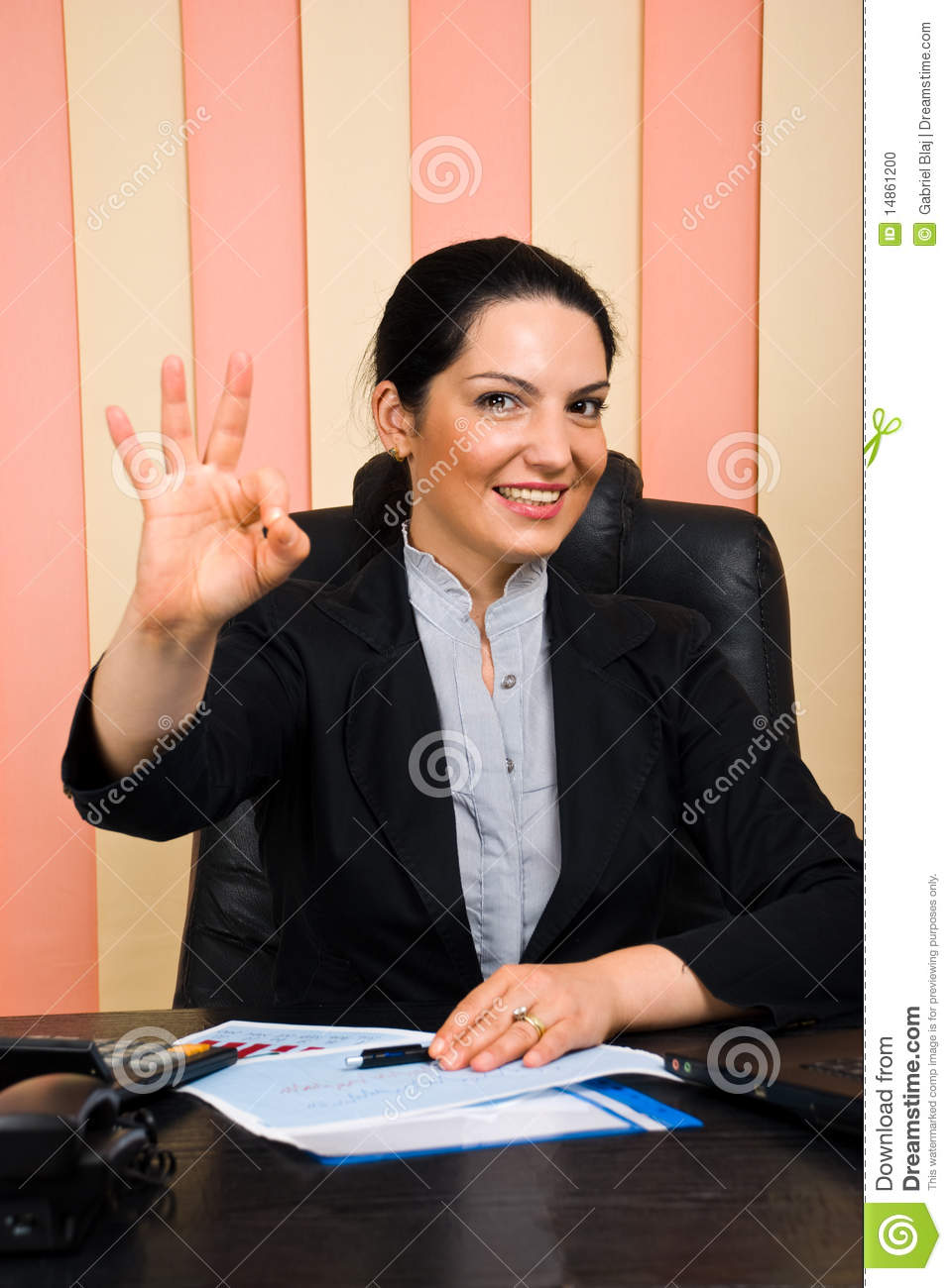 Happy business woman showing okay sign hand