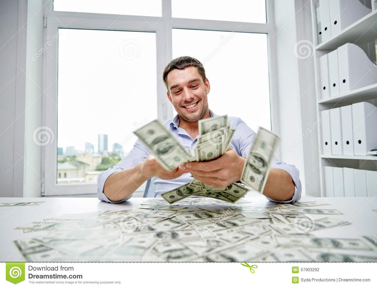 Happy Businessman With Heap Of Money In Office Stock Photo ...