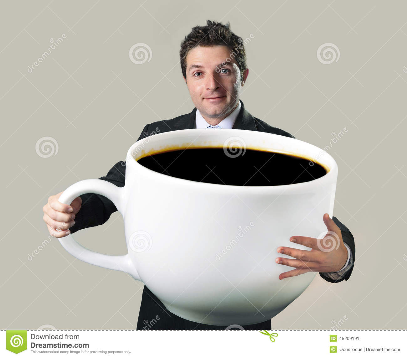 happy businessman holding funny huge oversized cup of black cof stock