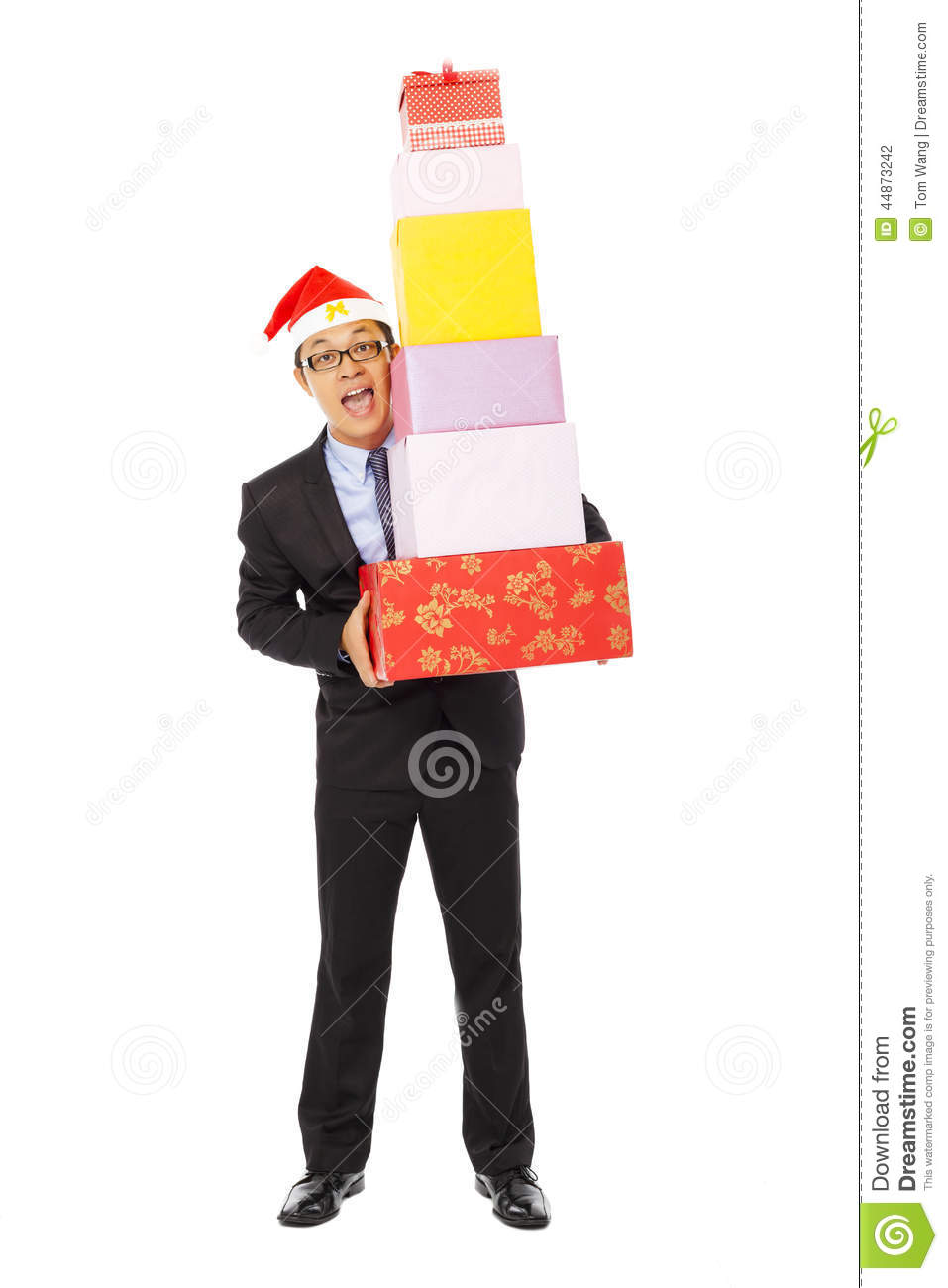 Happy businessman holding gift boxes . isolated on white