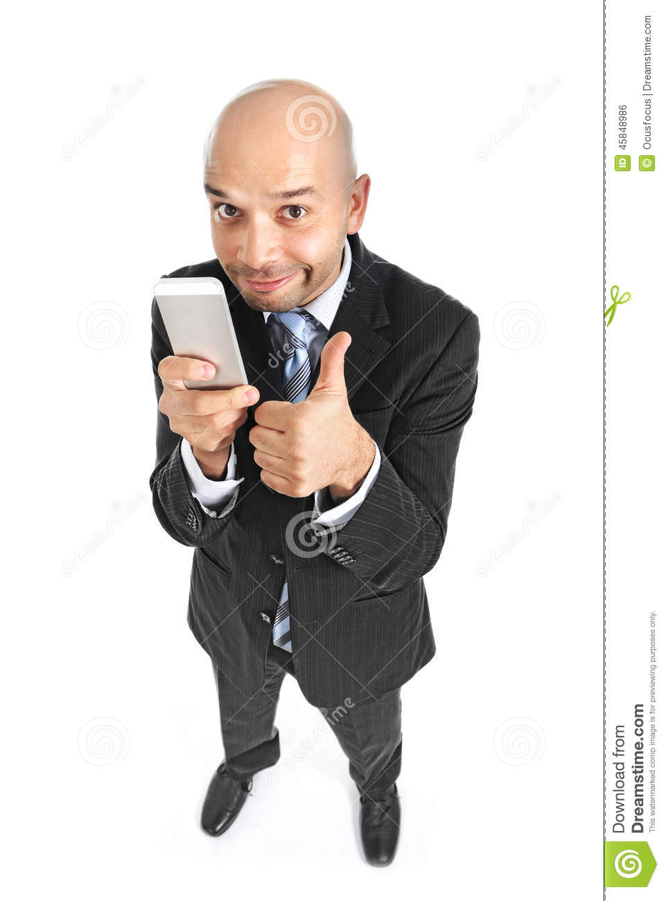 Happy businessman using compulsively cell phone smiling in mobil