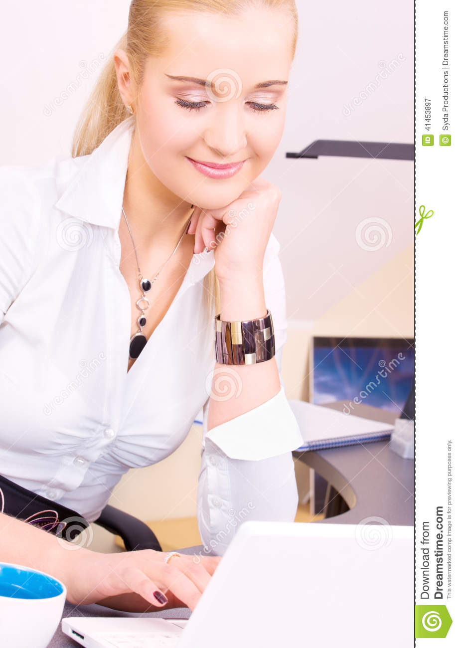 Happy businesswoman with laptop computer