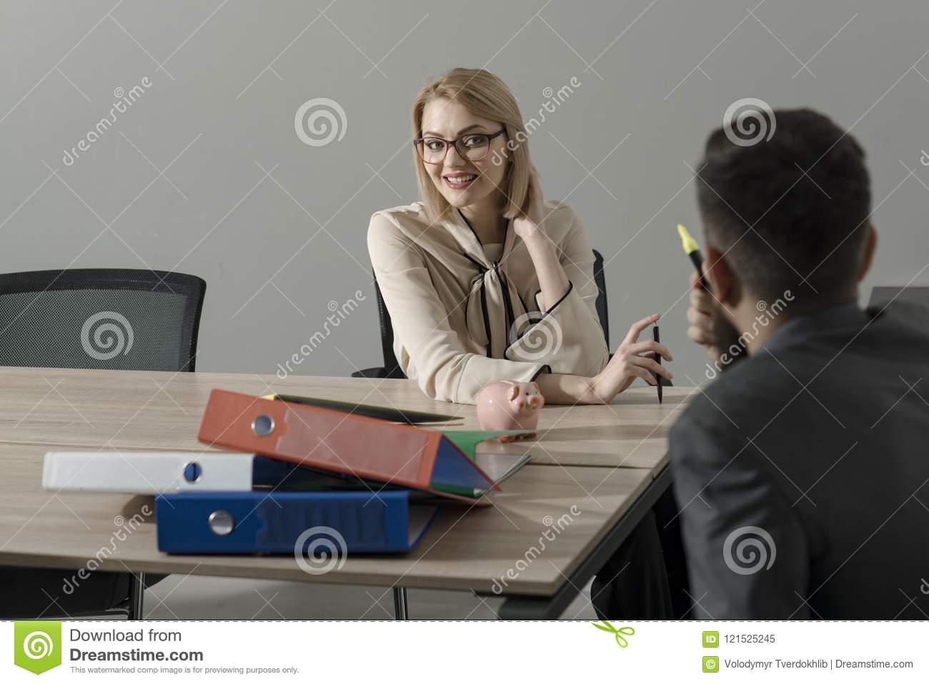 Happy businesswoman and manager at work process. Woman boss with financier in office. Sensual woman discuss company