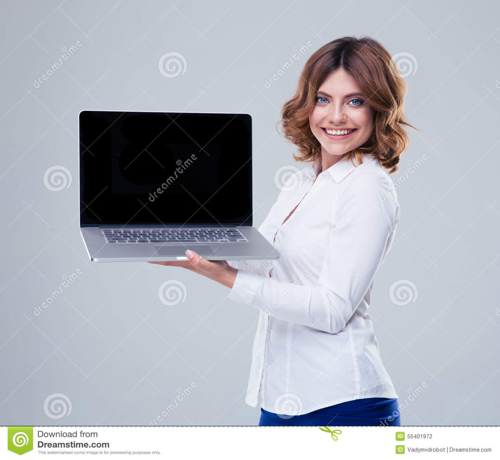 Happy businesswoman showing laptop screen