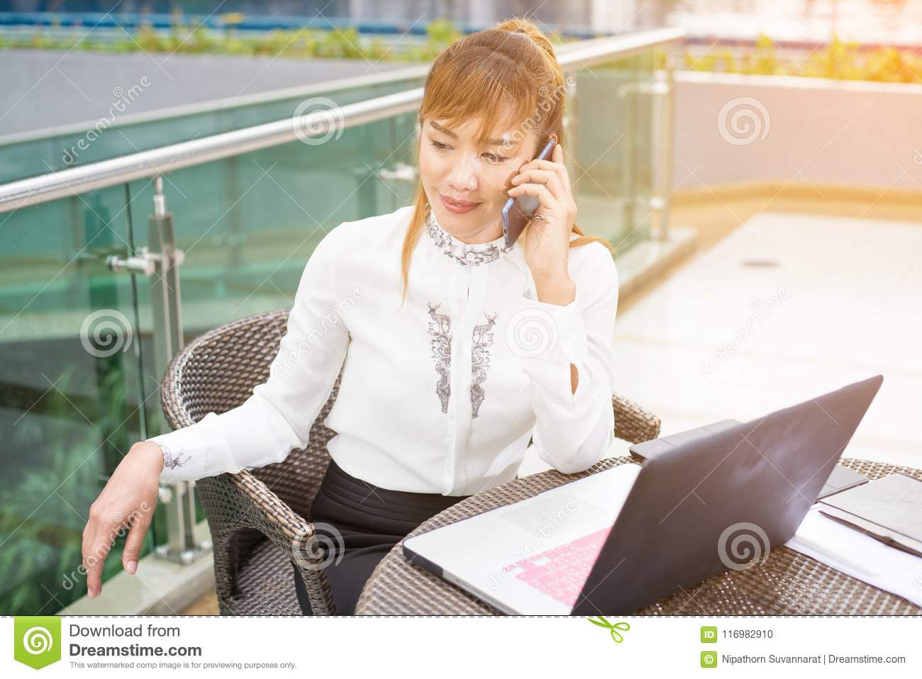 Happy Businesswoman Talking On Cell Phone In Office At Home Tele ...