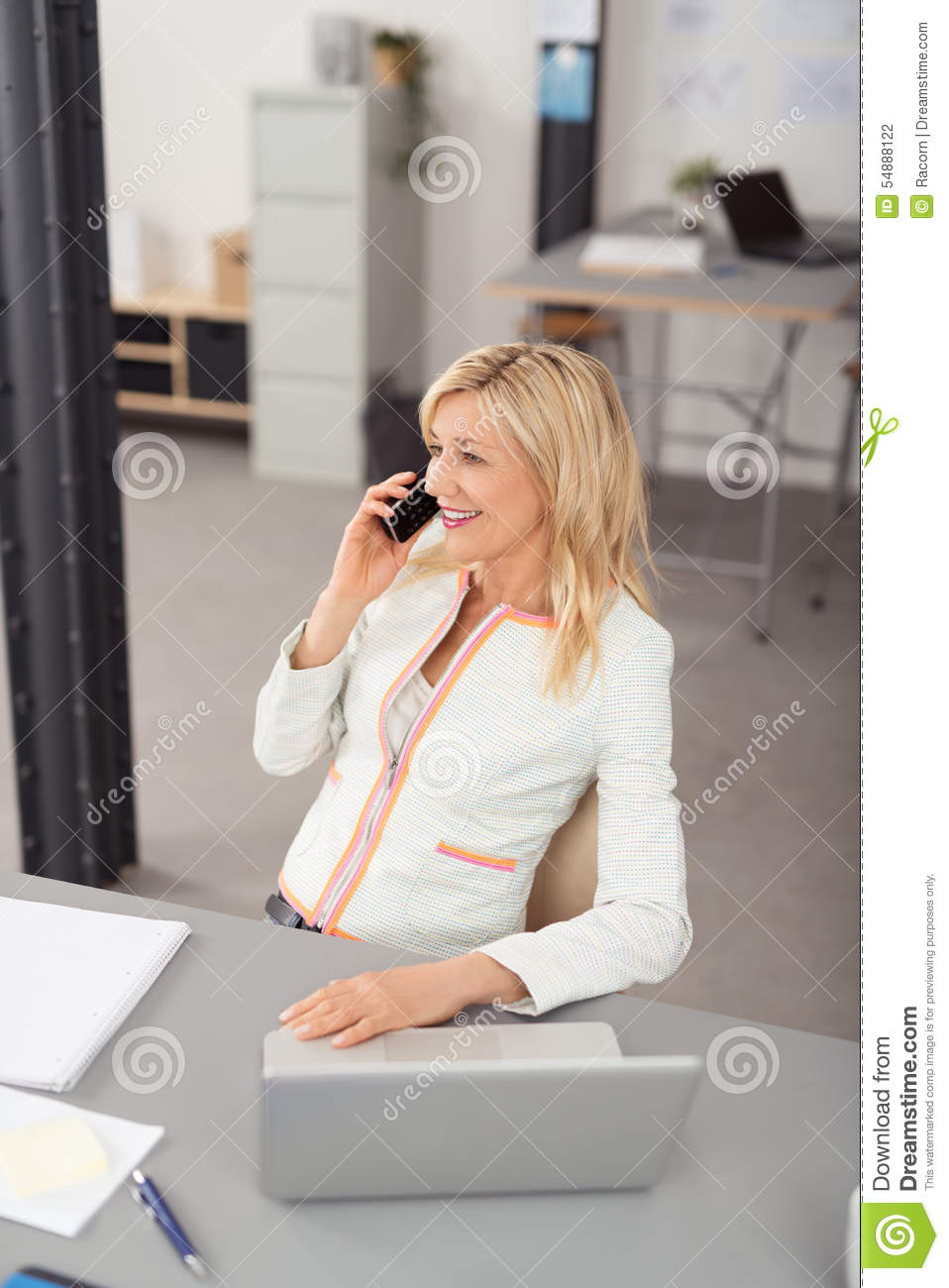 Happy Businesswoman Talking To Someone On Phone Stock Photo