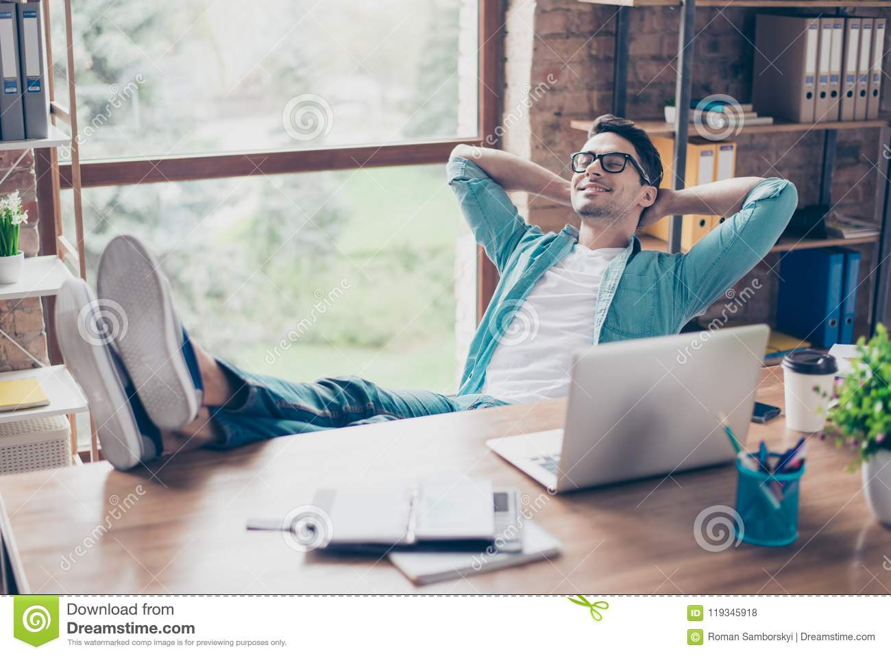 All The Tasks happy calm smiling man having a rest after solving all the