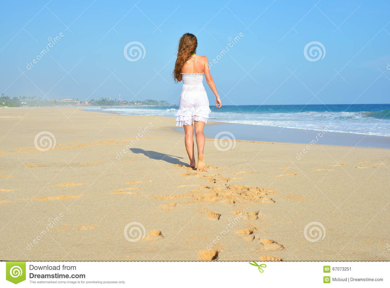 Woman walking on a beach royalty - Royalty Free Stock Photo Download Happy Carefree Woman Walking On Beach