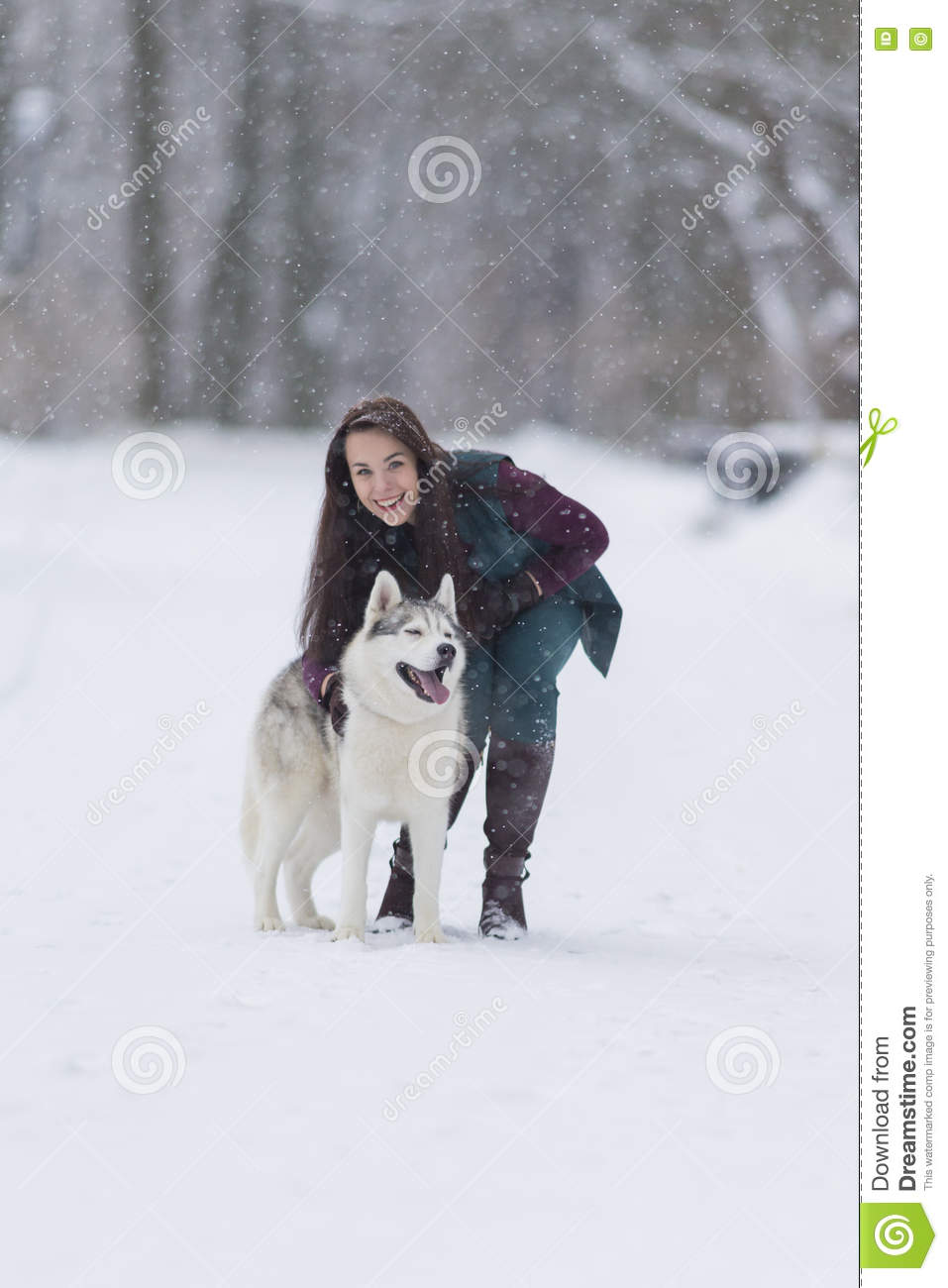 Girl with dog in snowy forest stock photography 50373452 - Keeping outdoor dog happy winter ...