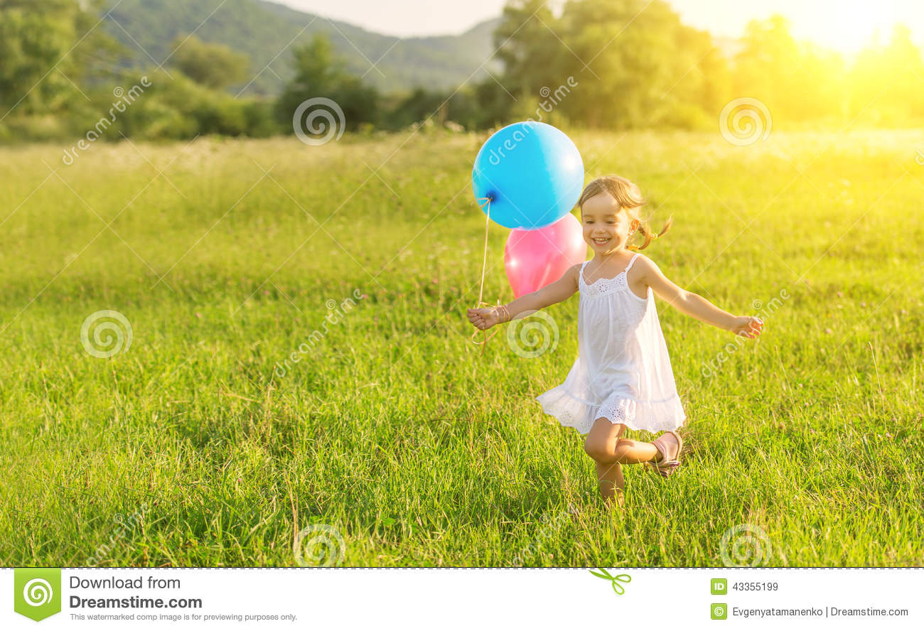 Happy cheerful girl playing and having fun with balloons for Cheerful nature