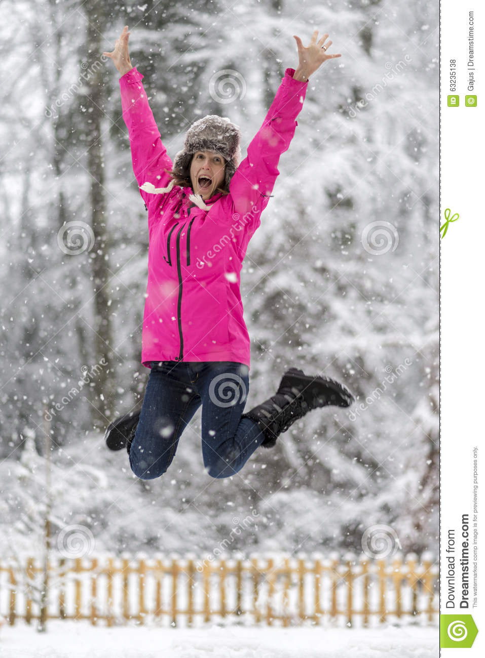 Happy cheerful young woman jumping high up in the air for Cheerful nature