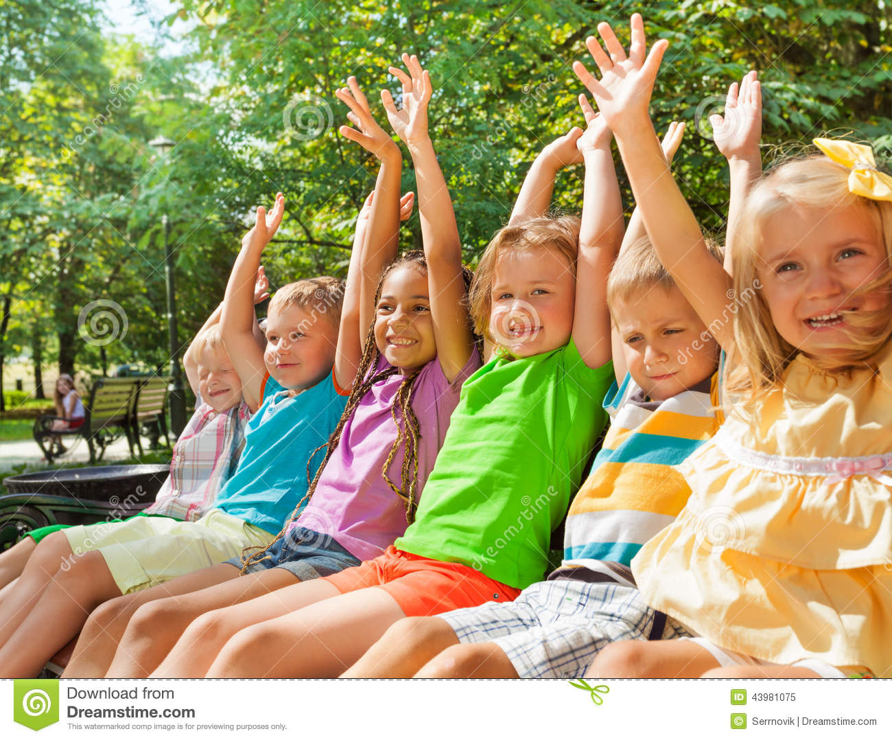 Happy Cheering Kids Lifting Hands On The Bench Stock Photo ...