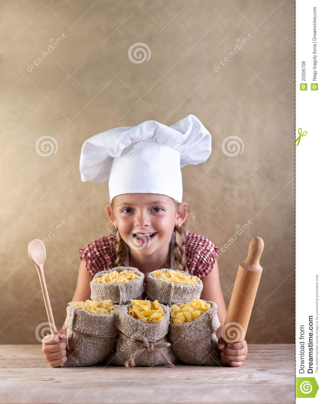 Download Happy Chef Child With Pasta Assortment Stock Photo - Image of little, sack: 25936708