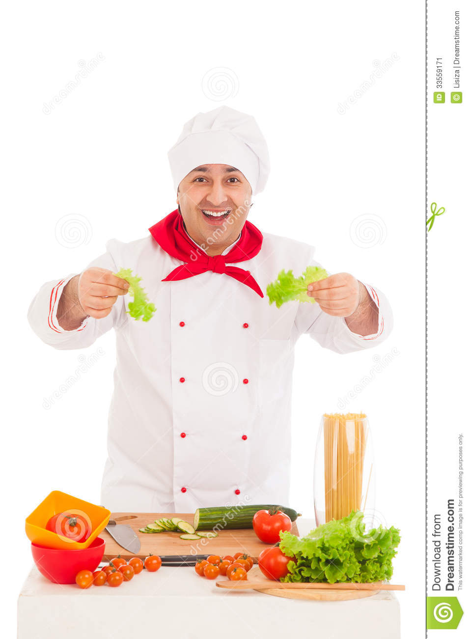 Happy chef holding leaf of salad and cooking with fresh for Fresh chef kitchen