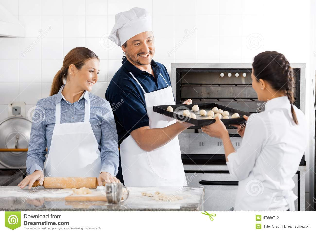 Happy Chefs Baking At Commercial Kitchen