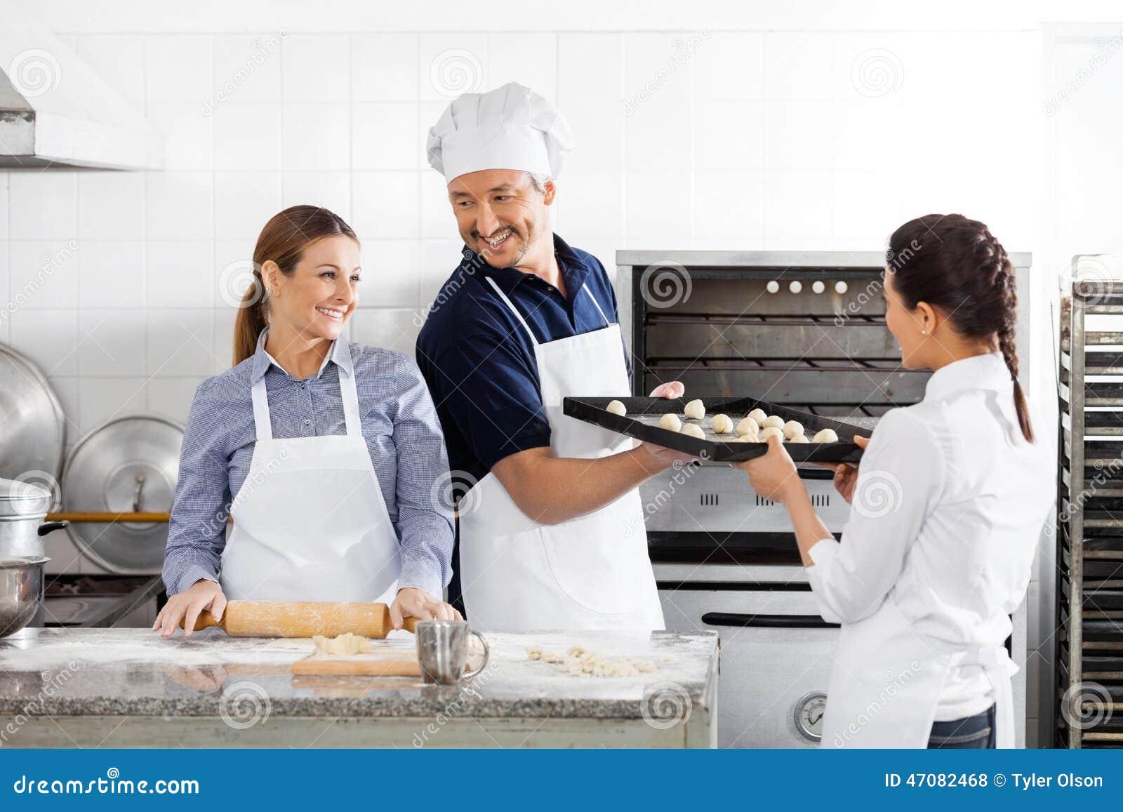 Happy Chefs Baking In Kitchen