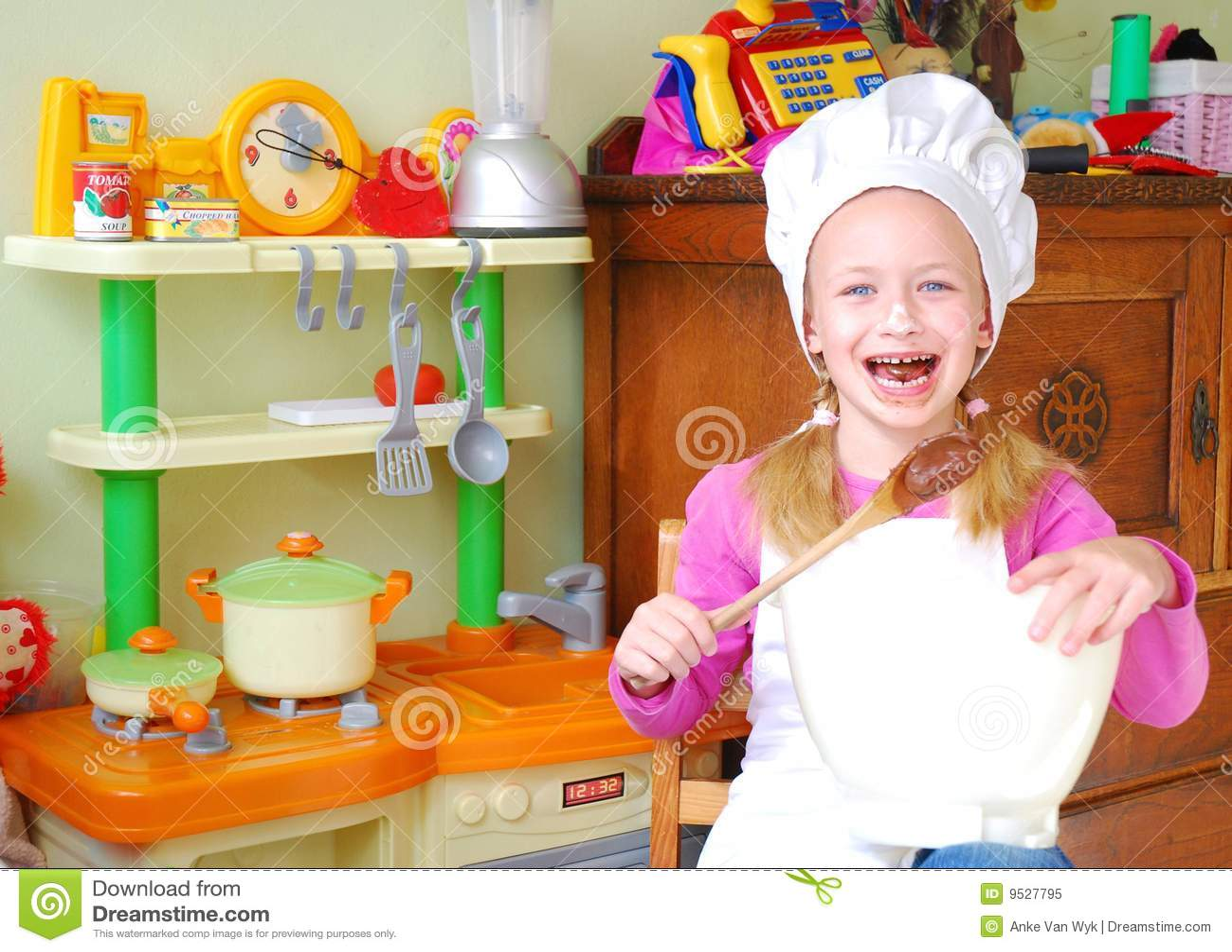 Happy child baker