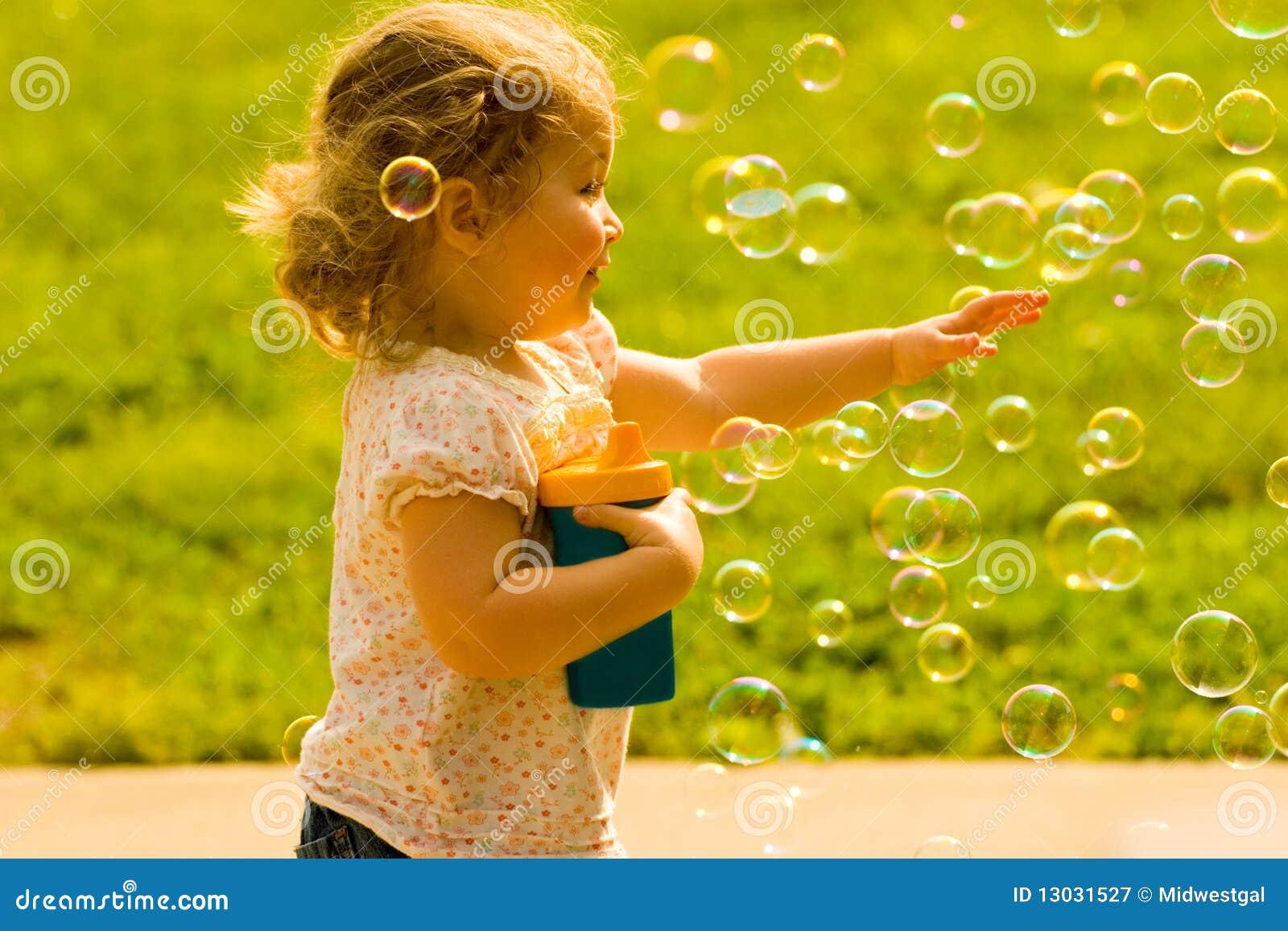 Happy Child Chasing Soap Bubbles