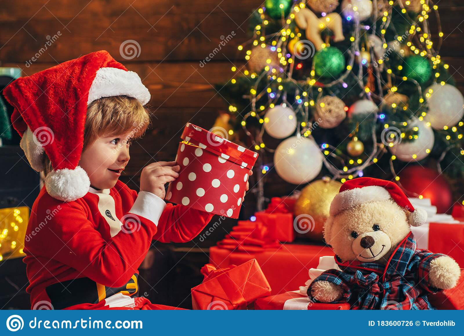 Happy Child With Christmas Gift New Year Kids Cheerful Cute Child Opening A Christmas Present Christmas Child Holding Stock Photo Image Of Idea Baby 183600726